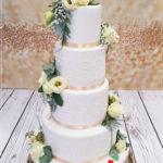 torty bialystok - weselny biały z żółtymi kwiatami